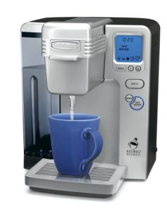 K-cup brewer with hot water on demand feature